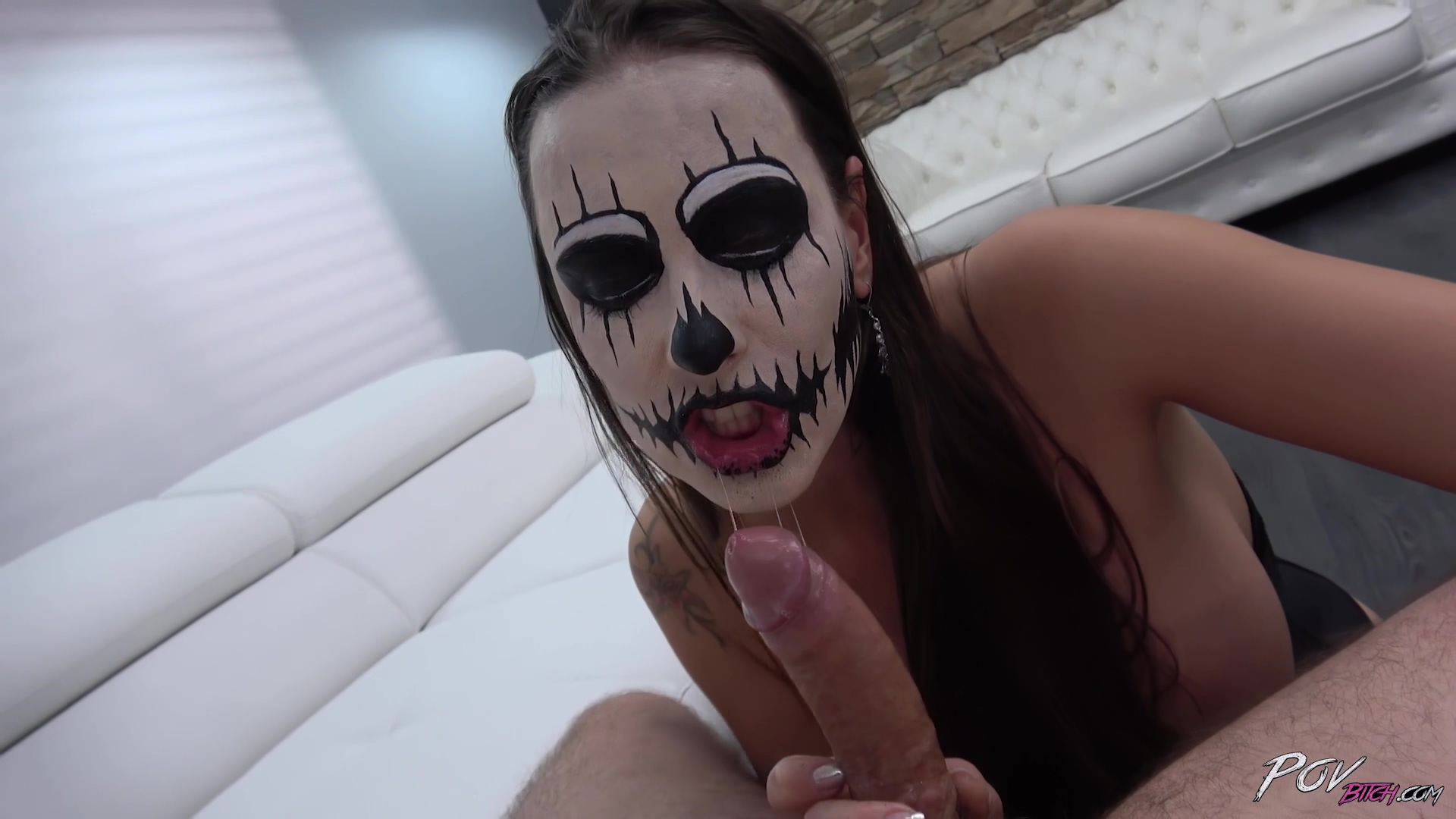 She's sucking dick with halloween face paint